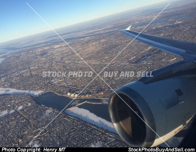 Stock photo - Airbus engine wing view over Montreal
