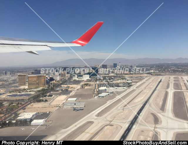 Stock photo - Las Vegas airport takeoff wing view