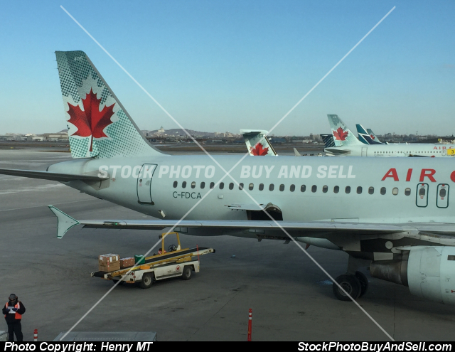 Stock photo - Air Canada Airbus and tails Montreal airport