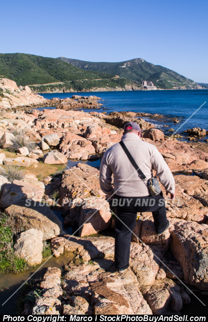 Stock photo - Man looking the scenic coast of Teulada, in southwestern Sardinia