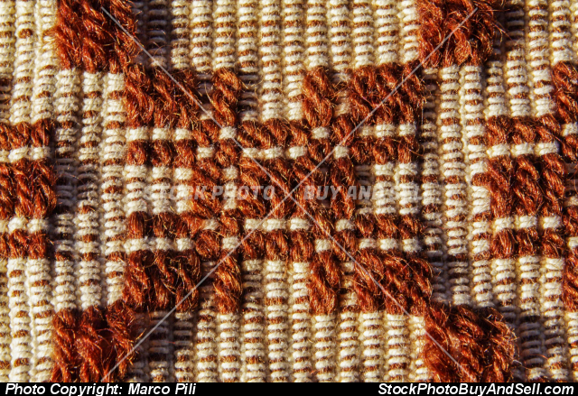 Stock photo - Handcrafted wool weaving. Detail of a traditional Sardinian carpet with geometric decoration