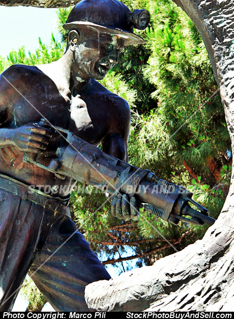 Stock photo - Il Minatore.Statua bronzea dedicated to miners who worked in the coal mines of south-west Sardinia