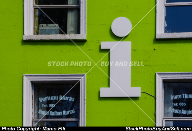 Stock photo - Big character minus I installed on a green facade of a building in Dublin, character,  sign, signal, white . Signal of Information Office