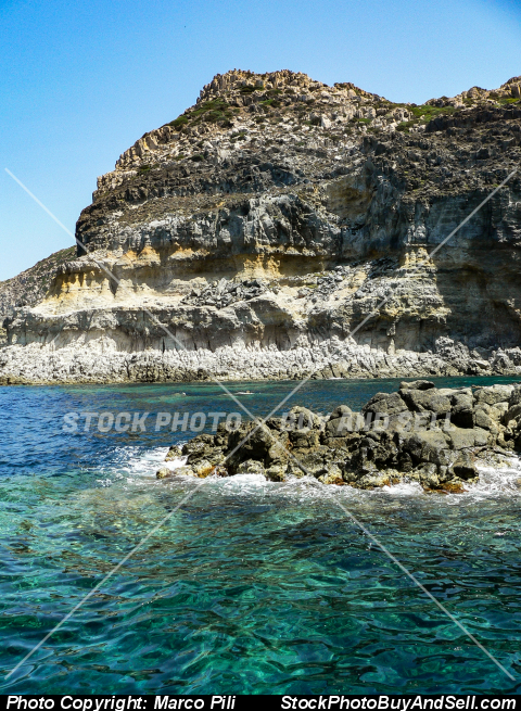 Stock photo - Geological landscapes. Ancient volcanic cliff on the Mediterranean sea