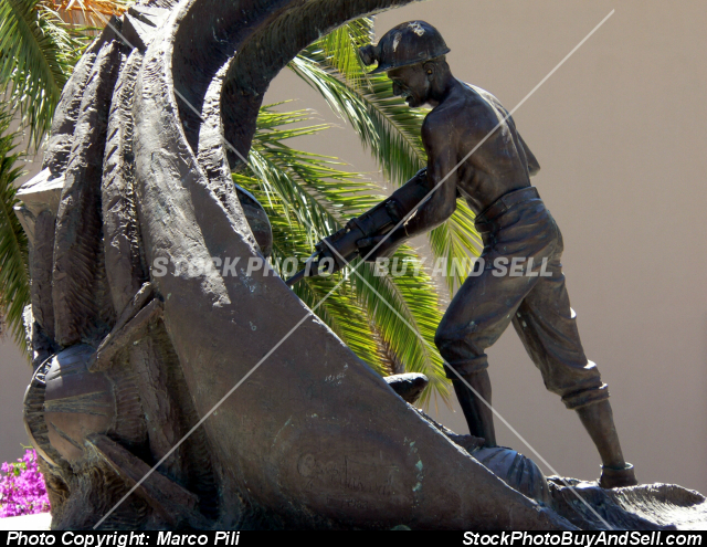 Stock photo - The Miner. Bronze statue dedicated to miners who worked in the coal mines of south-west Sardinia