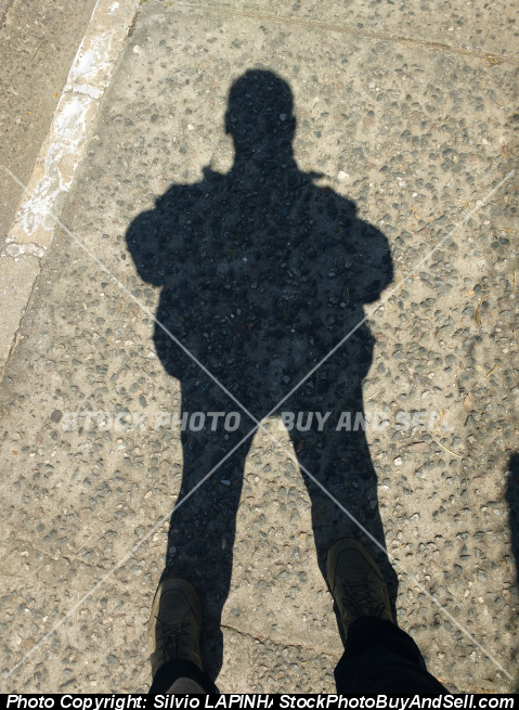 Stock photo - Shadow of standing man in sunny day.